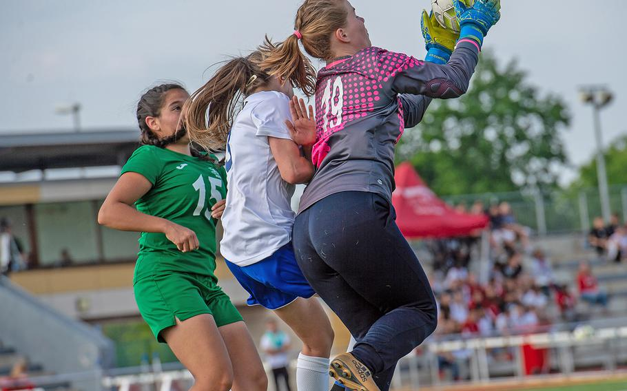 Naples goalie Riley Howland grabs the ball during the girls Division I DODEA-Europe soccer championship game against Wiesbaden, Thursday, May 23, 2019. Wiesbaden won the game 2-0.