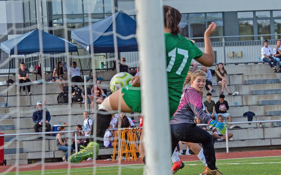 Naples goalie Riley Howland looks back as teammate Genesis Torrent uses her leg to stop a goal during the girls Division I DODEA-Europe soccer championship game against Wiesbaden, Thursday, May 23, 2019. Wiesbaden won the game 2-0.