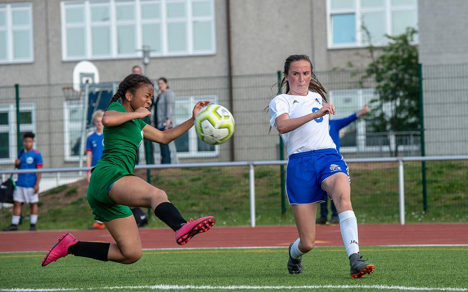 Wiesbaden's Erin Goodman cross the ball to the center of the field as Naples' Tatiana Manning tries to block during the girls Division I DODEA-Europe soccer championship game, Thursday, May 23, 2019. Wiesbaden won the game 2-0.
