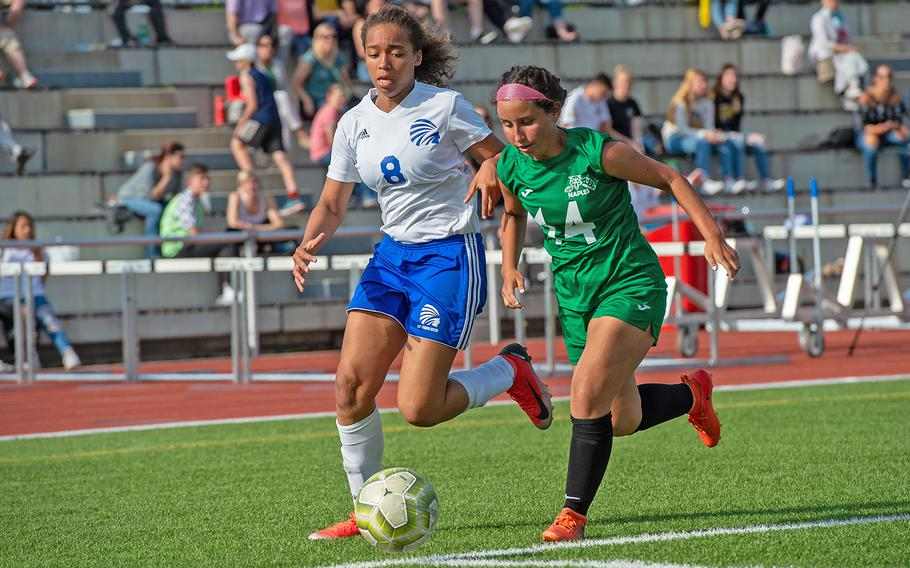Wiesbaden's Jade Anderson and Naples' Anna Brennick battle for the ball during the girls Division I DODEA-Europe soccer championship game, Thursday, May 23, 2019. Wiesbaden won the game 2-0.