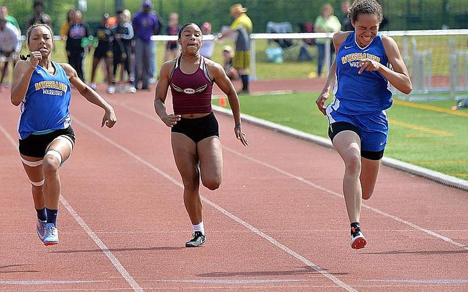 Wiesbaden's Isabella Pizarro, right, races her teammate Whitney Bivins to the finish line to win the girls 100-meter dash title at the DODEA-Europe track and field finals in 12.52 seconds to Bivins 12.53. At center is Vilseck's Dionne Mayfield, who finished fifth. Pizarro also won the triple jump with a 33 feet, 9 inch leap.