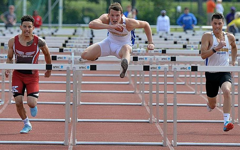 Wiesbaden's Garett Armel has his eyes on the finish line as he clears the final hurdle in the 110-meter hurdle race at the DODEA-Europe track and field finals in Kaiserslautern, Saturday, May 25, 2019. He won in 15.16 seconds ahead Kaiserslautern's Alapae Turgeon, left. Callum Wallace, at right, finished fifth.