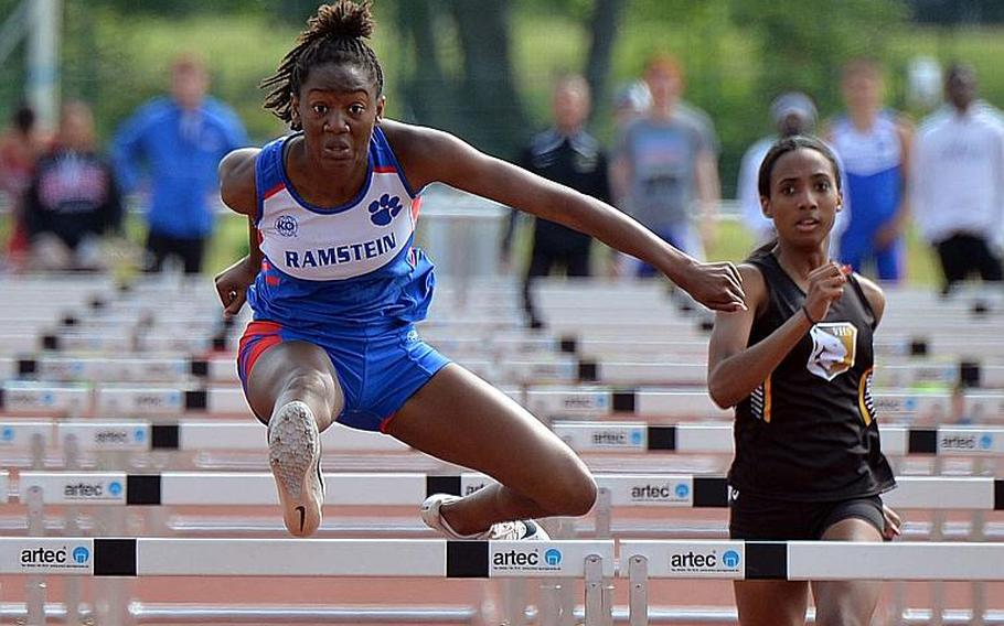 Ramstein's Jaya Worthington clears the next to last hurdle on her way to winning the girls 100-meter hurdles in 16.07 seconds at the DODEA-Europe track and field finals in Kaiserslautern, Saturday, May 25, 2019. At right is Vicenza's Ivani Turner, who finished third.
