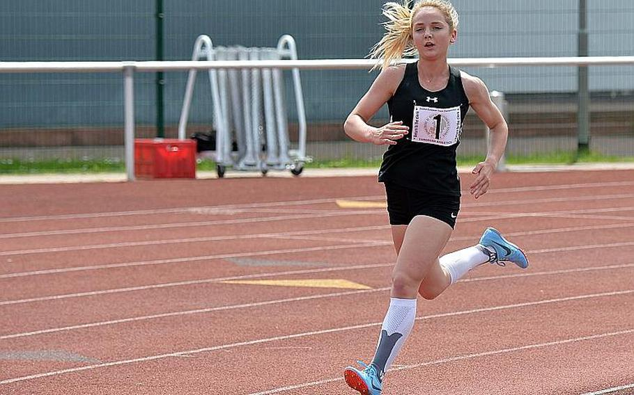 Stuttgart's McKinley Fielding runs alone after outpacing the competition on her way to winning the the 3,200-meter race in a new DODEA-Europe record of 11 minutes, 7.78 seconds, beating the old record by almost 20 seconds on Saturday, May 25, 2019. A day earlier she also broke the record in the 1,600.