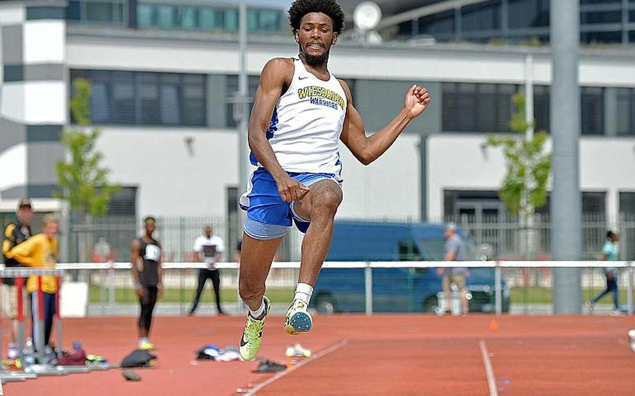 Wiesbaden??s Markez Middlebrooks won the long jump competition with a leap of 21 feet, 9.75 inches at the DODEA-Europe track and field finals in Kaiserslautern, Saturday, May 25, 2019. He also won the 100-meter and 200-meter dashes.  MICHAEL ABRAMS/STARS AND STRIPES