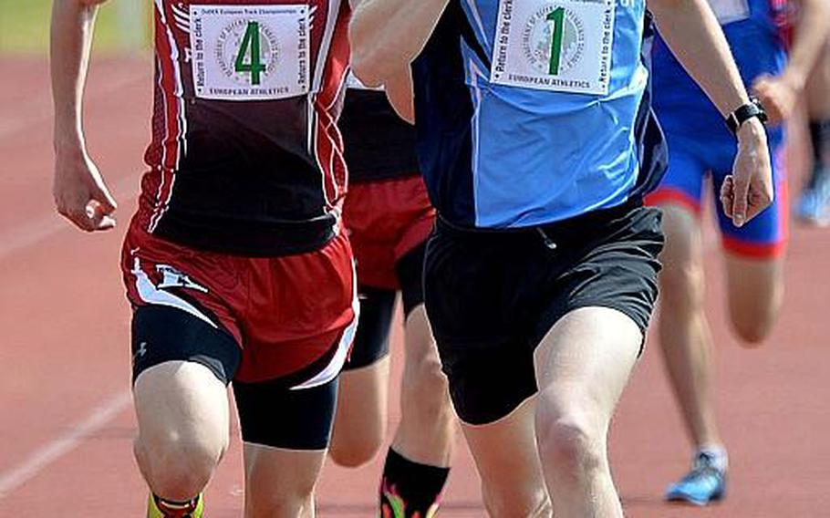 Black Forest Academy's Mac Roberts leads Kaiserslautern's Joseph Purvis to the finish line in the 1,600-meter run, winning in 4 minutes, 30.22 seconds at the DODEA-Europe track and field finals in Kaiserslautern, Saturday, May 25, 2019.