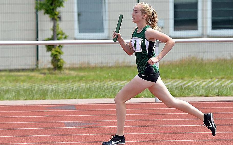 Naples' Alyssa McKamey anchors her team's victory in the 1,600-meter sprint medley at the DODEA-Europe track and field finals in Kaiserslautern, Saturday, May 25, 2019. The Wildcats took the 2019 title with a run of 4 minutes, 32.26 seconds.