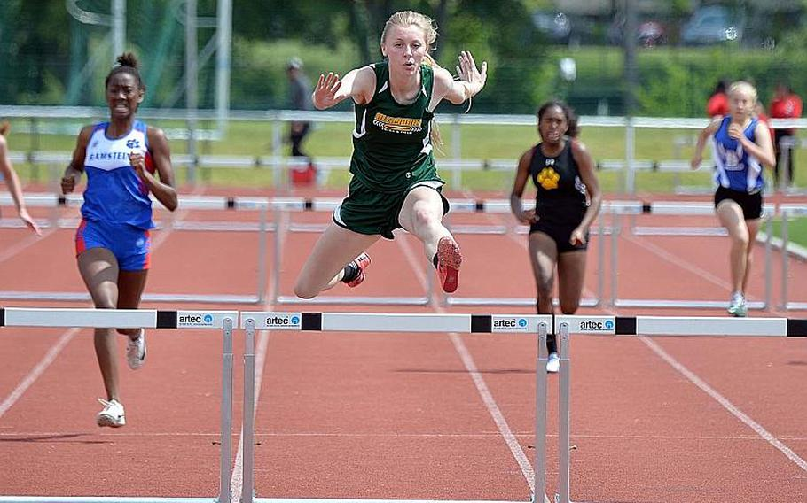 Alconbury's Marissa Kastler clears the final hurdle on her way to winning the 300-meter hurdle event at the DODEA-Europe track and field finals in 48.62 seconds.