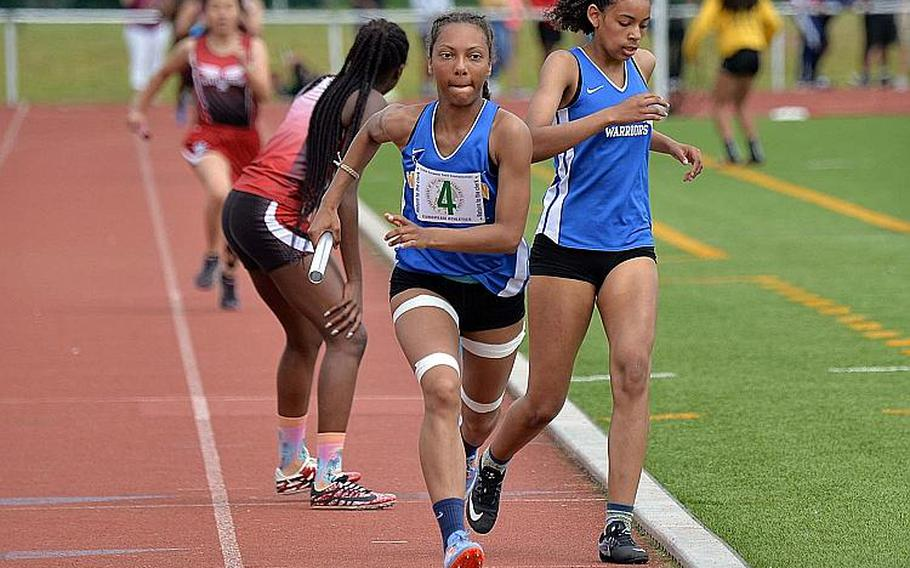 Wiesbaden's Whitney Bivins spurts off on the last leg of the 4x400-meter relay after taking the baton form Catianna Binyard-Turner. The duo along with teammates Myriam Friel and Ashanti Scott won the race in 4 minutes, 10.59 seconds at the DODEA-Europe track and field finals in Kaiserslautern, Saturday, May 25, 2019.