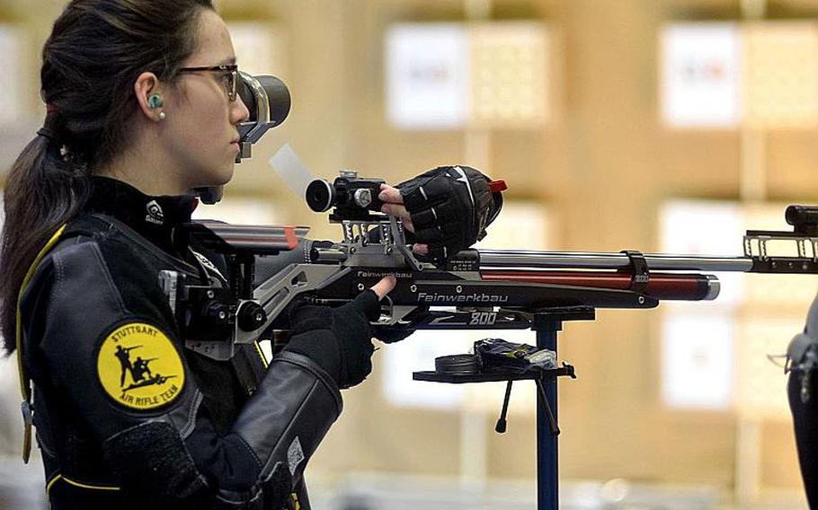 Maria Tortorelli adjusts the sight on her air rifle while preparing to shoot during the 2019 European Championships, in Wiesbaden, Germany, Saturday, Feb 2, 2019.