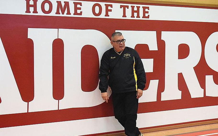Stuttgart coach Raul Pinon celebrates his team's victory at the 2019-20 DODEA-Europe marksmanship championship meet Saturday at Kaiserslautern High School. This season is Pinon's last as head coach of the Panthers.