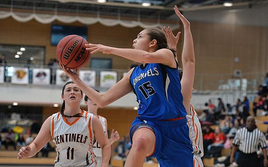 June Smith of Hohenfels gets past Emerson Retka to go to the basket as Izzy Smith watches the action in the girls Division III final at the DODEA-Europe basketball championships in Wiesbaden, Germany, Saturday, Feb. 22, 2020. Spangdalem took the title with a 37-21 win.