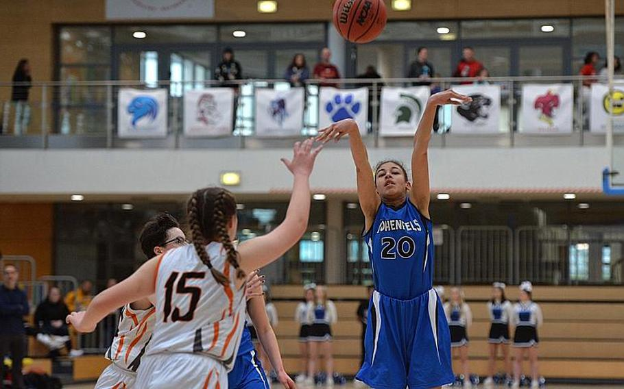 Jania Vicente of Hohenfels gets off a shot over Emerson Retka of Spangdahlem in the girls Division III final at the DODEA-Europe basketball championships in Wiesbaden, Germany, Saturday, Feb. 22, 2020. Spangdahlem won 37-21.