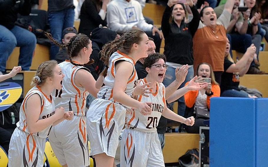 The Spangdahlem Sentinels celebrate their girls Division III title after defeating Hohenfels 37-21 at the DODEA-Europe basketball championships in Wiesbaden, Germany, Saturday, Feb. 22, 2020. Spangdahlem won 37-21.