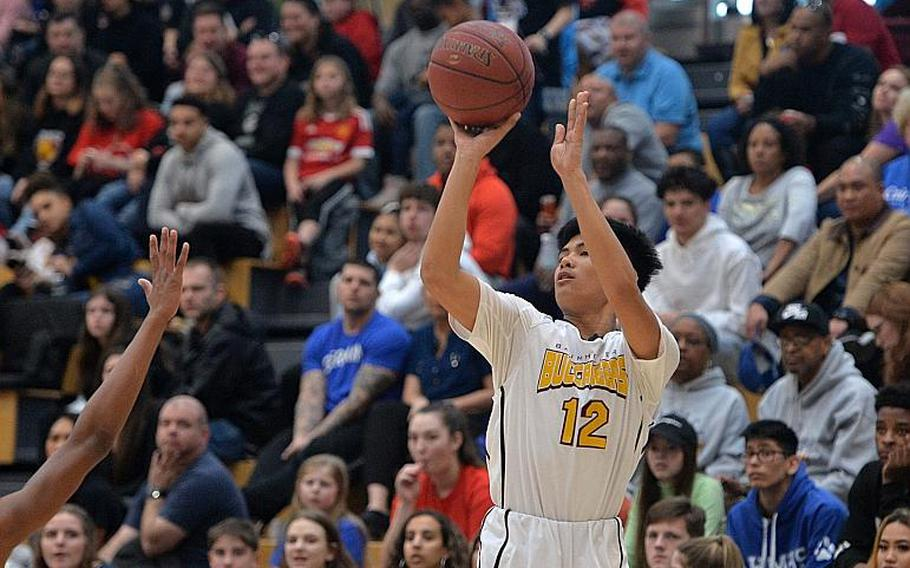 Isaiah Daep of Baumholder hits a three-pointer in the boys Division III championship game at the DODEA-Europe basketball finals in Wiesbaden, Germany, Saturday, Feb. 22, 2020. Baumholder won its third title in a row with a 50-43 win.