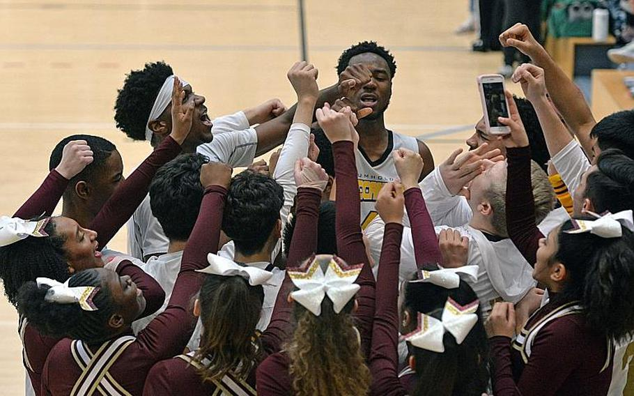 The Baumholder Buccaneers players and cheerleaders celebrate their third Division III title in a row after defeating Ansbach 52-31 at the DODEA-Europe basketball finals in Wiesbaden, Germany, Saturday, Feb. 22, 2020.