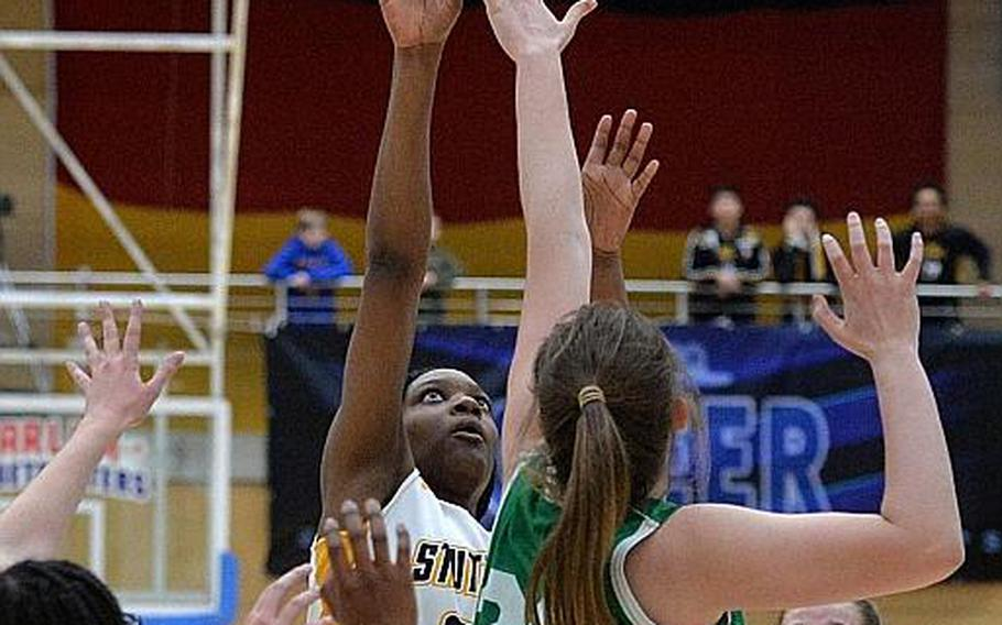 Jaela Ashley of Stuttgart shoots over Elena Vassos-Lavere  in the girls Division I final at the DODEA-Europe basketball championships in Wiesbaden, Germany, Saturday, Feb. 22, 2020.