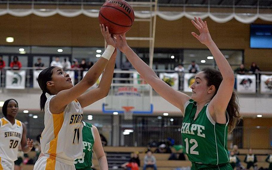 Victoria Antoine of Stuttgart shoots as Claudia Commi defends in the girls Division I final at the DODEA-Europe basketball championships in Wiesbaden, Germany, Saturday, Feb. 22, 2020.