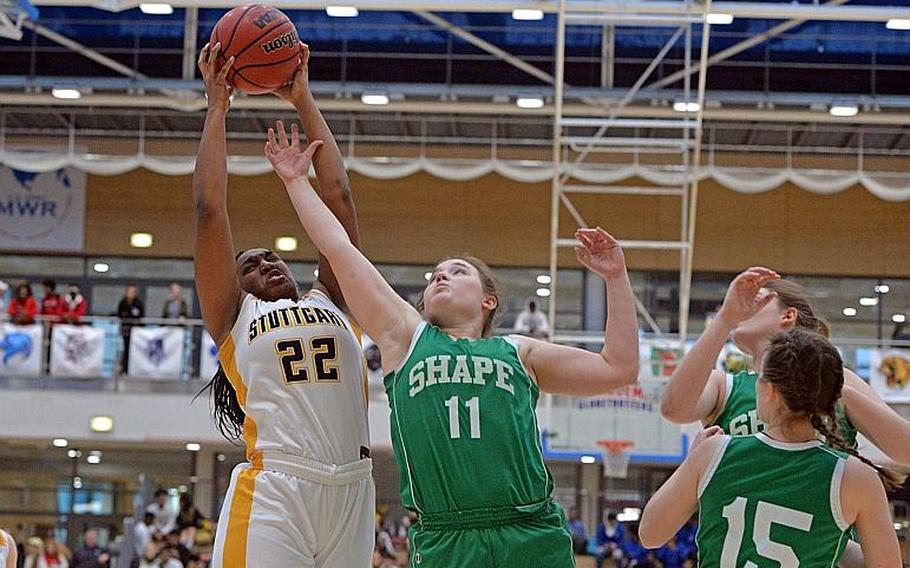 Skye DaSilva Matis of Stuttgart pulls down a rebound against McKenzie Barden of SHAPE in the girls Division I final at the DODEA-Europe basketball championships in Wiesbaden, Germany, Saturday, Feb. 22, 2020.
