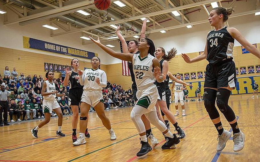 Naples' Mia Rawlins takes a shot during the DODEA-Europe 2020 Division II Girls Basketball Championship game against Vicenza at the Wiesbaden High School, Germany, Saturday, Feb. 22, 2020. Naples won the game 44-35.