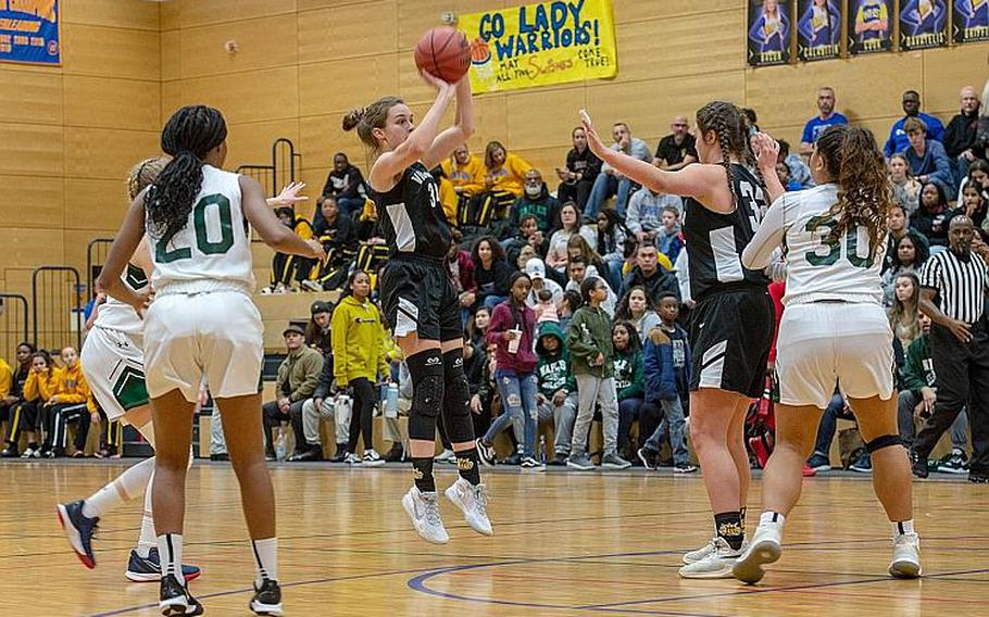 Vicenza's Claire Troiano shoots and makes a three-point shot during the DODEA-Europe 2020 Division II Girls Basketball Championship game against Naples at the Wiesbaden High School, Germany, Saturday, Feb. 22, 2020. Naples won the game 44-35.