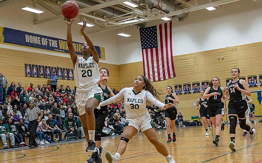 Naples' Serina Alderson goes in for a lay-up during the DODEA-Europe 2020 Division II Girls Basketball Championship game against Vicenza at the Wiesbaden High School, Germany, Saturday, Feb. 22, 2020. Naples won the game 44-35.