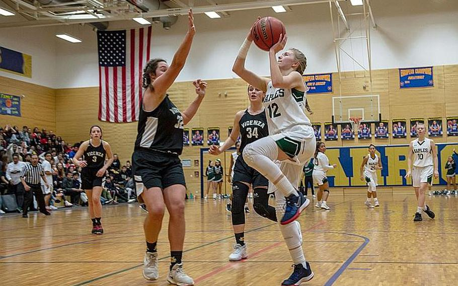 Naples' Roxanne Sasse drives to the basket during the DODEA-Europe 2020 Division II Girls Basketball Championship game against Vicenza at the Wiesbaden High School, Germany, Saturday, Feb. 22, 2020. Naples won the game 44-35.