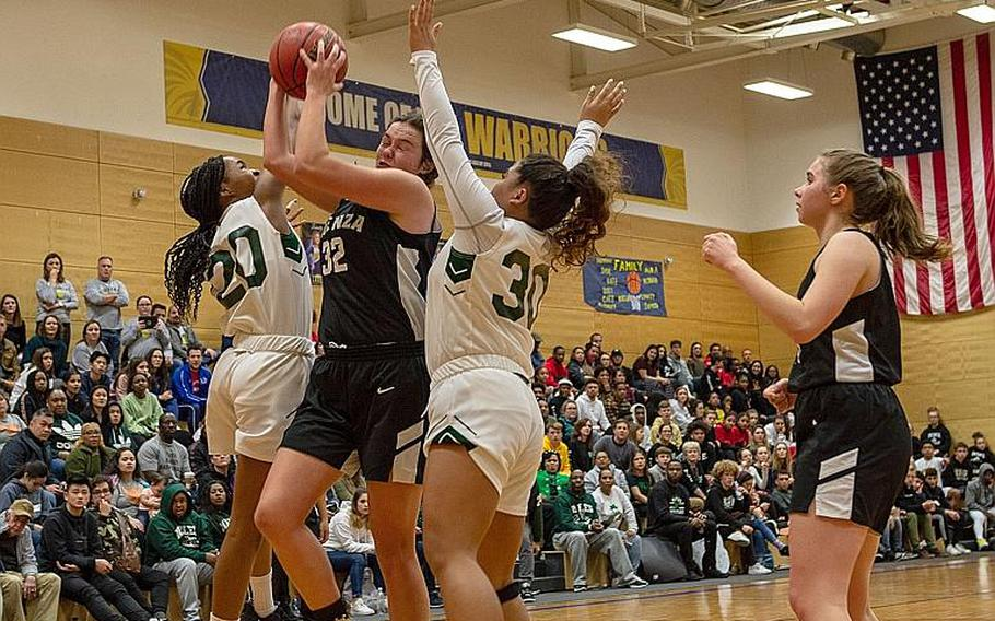 Players from Naples and Vicenza fight for a rebound during the DODEA-Europe 2020 Division II Girls Basketball Championship game at the Wiesbaden High School, Germany, Saturday, Feb. 22, 2020. Naples won the game 44-35.