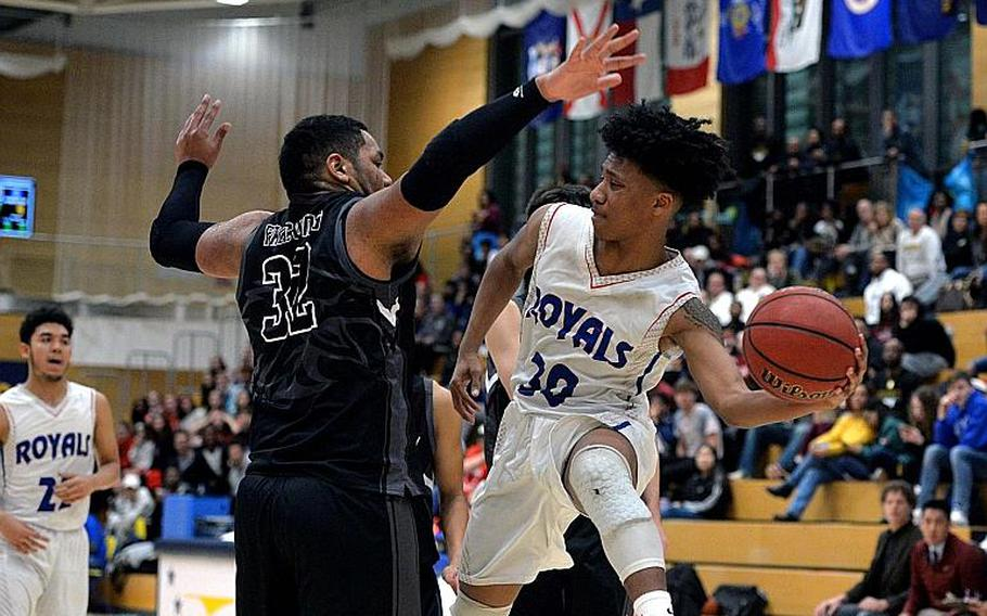 Jerod Little of Ramstein passes around Jonas Matthews of Vilseck in the boys Division I final at the DODEA-Europe basketball championships in Wiesbaden, Germany, Saturday, Feb. 22, 2020. Vilseck took the title with a 56-42 win.