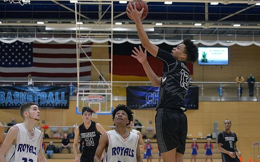 Matthew Gardner of Vilseck goes in for a basket before the Ramstein defense of Luis Figueroa and Jerod Little can stop him in the boys Division I final at the DODEA-Europe basketball championships in Wiesbaden, Germany, Saturday, Feb. 22, 2020. Vilseck took the title with a 56-42 win.
