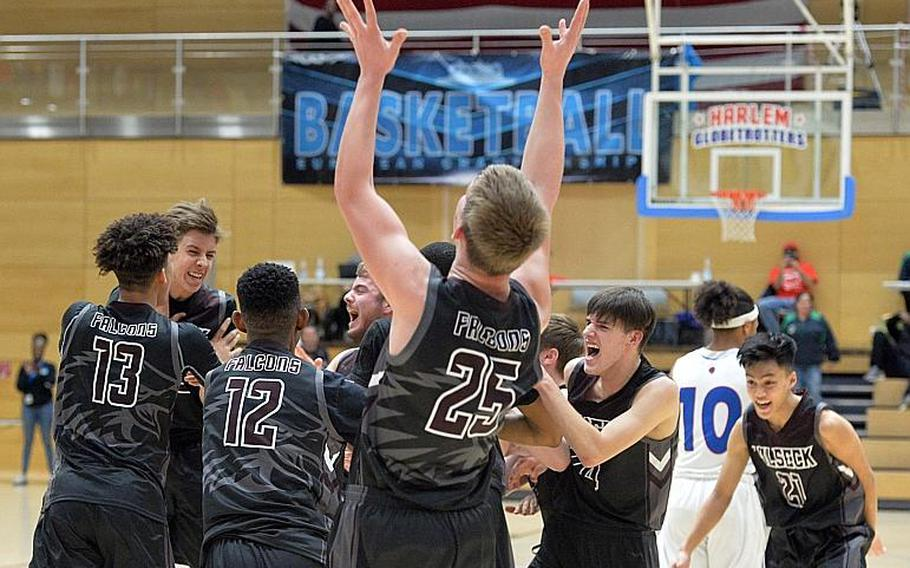 The Vilseck Falcons celebrate their Division I title after defeating the Ramstein Royals 56-42 in the Division I final at the DODEA-Europe basketball championships in Wiesbaden, Germany, Saturday, Feb. 22, 2020.