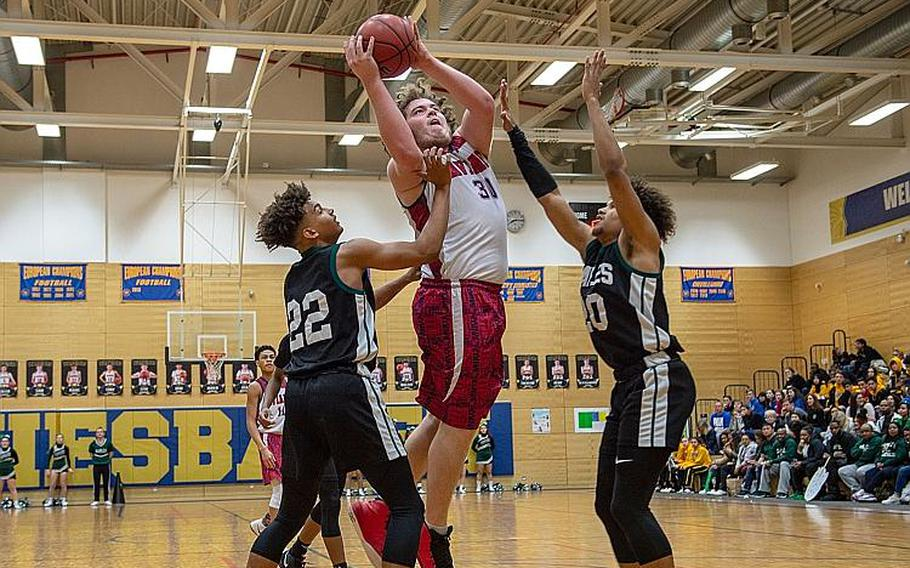 Aviano's Ben Broome goes up for a shot during the DODEA-Europe 2020 Division II Boys Basketball Championship game against Naples at Wiesbaden High School, Germany, Saturday, Feb. 22, 2020. Naples won the game 40-35.