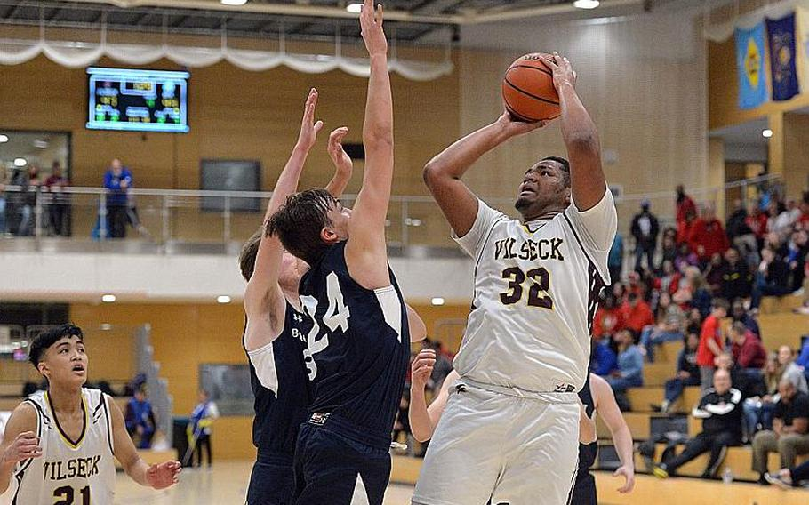 Jonas Matthews of Vilseck gets a shot off against Black Forest Academy in a boys Division I semifinal at the DODEA-Europe basketball championships in Wiesbaden, Germany, in February.  MICHAEL ABRAMS/STARS AND STRIPES