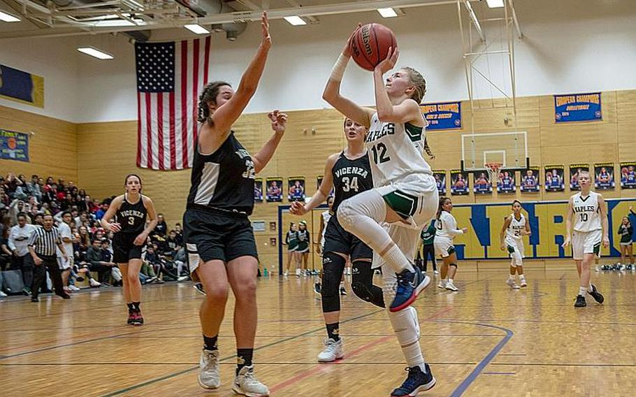 Naples' Roxanne Sasse drives to the basket during the DODEA-Europe 2020 Division II Girls Basketball Championship game against Vicenza at the Wiesbaden High School, Germany, Feb. 22, 2020. Sasse was named DODEA-Europe's female Athlete of the Year for the 2019-20 school year.