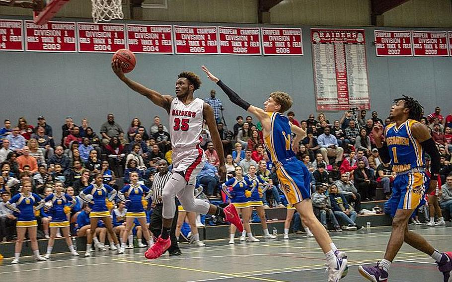 Kaiserslautern's Tre Dotson drives for a lay-up during a basketball game against Wiesbaden in Kaiserslautern, Germany, Jan. 31, 2020. Dotson was named DODEA-Europe's male co-Athlete of the Year for the 2019-20 school year.