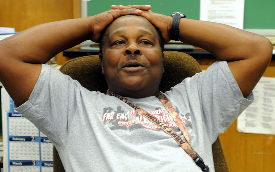 Retiring Kubasaki High School track and field coach Charles Burns.