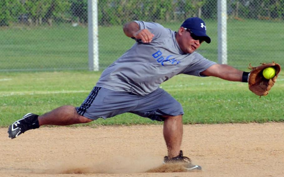 Third baseman Anberto Oliveras of 3rd Maintenance Battalion Bombers of Camp Kinser, Okinawa, lunges to snag an American Legion ground ball during the opening game in the 2011 Firecracker Shootout Pacificwide interservice softball tournament at Field 1, Gunners Fitness & Sports Complex, Camp Foster, Okinawa, June 30. Legion won 20-0.
