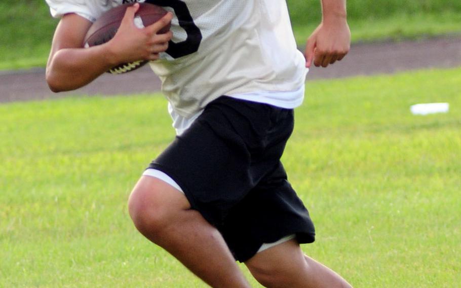 Kadena Panthers junior Joseph Hermon returns a kickoff during practice.