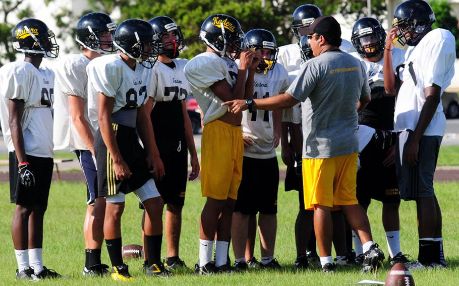 Coach Sergio Mendoza chats it up with his charges during practice. He's won three Far East Division I titles at the Kadena Panthers' helm, including the last two, but his 2011 team returns just two players and his roster is comprised of 90 percent freshmen and sophomores.