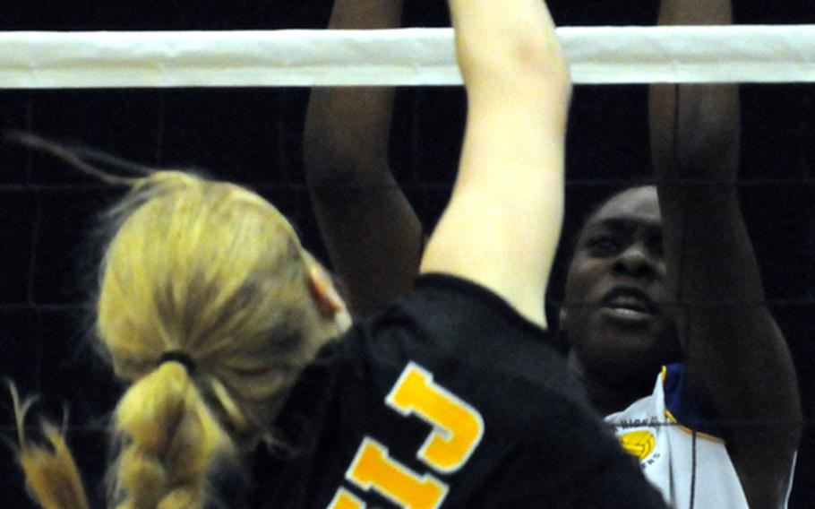 American School In Japan middle blocker Liz Thornton spikes through the block of Yokota Panthers middle blocker Reonna Richberg during Tuesday's Kanto Plain Association of Secondary Schools girls volleyball match at Yokota High School, Japan. ASIJ rallied from a one-set deficit to win 19-25, 25-20, 25-20, 25-10.