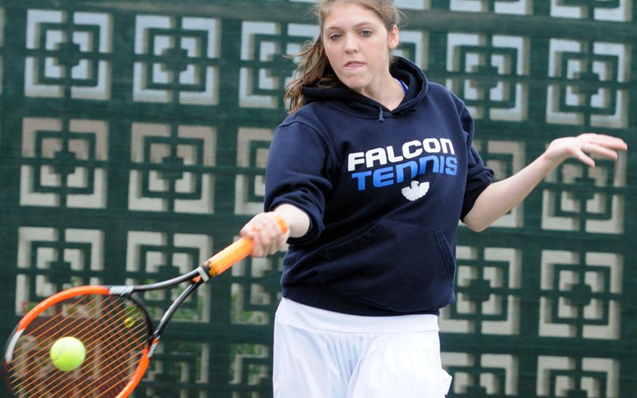 Carson Allen of Seoul American Falcons launches a forehand during Monday's first-round girls doubles match in the Far East High School Tennis Tournament at Risner Tennis Complex, Kadena Air Base, Okinawa. Allen and Ashley Cho lost to Nile C. Kinnick's Aiko Allan and Kyra Nguyen 8-5.