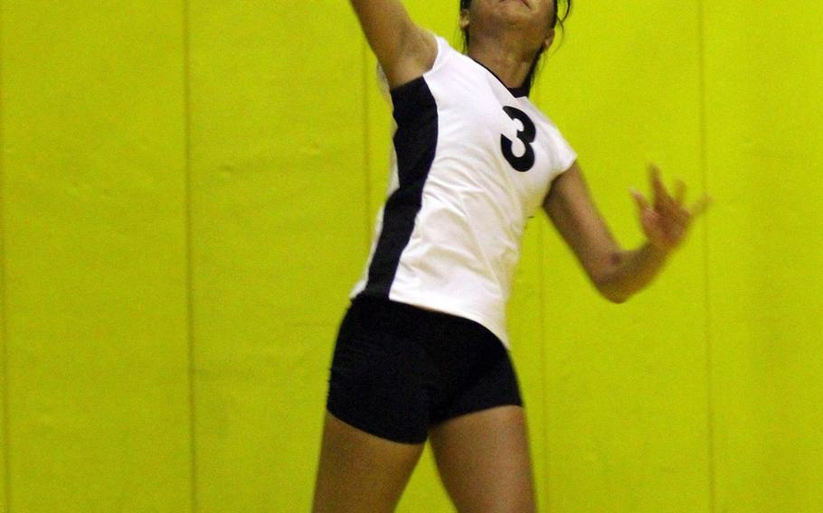 Kadena middle blocker Nia Rodriguez readies a serve attempt against Kubasaki  during Tuesday's Okinawa Activities Council regular-season girls volleyball opener at Kadena Air Base, Okinawa. Kadena rallied to win 23-25, 25-18, 15-25, 25-12, 15-11.