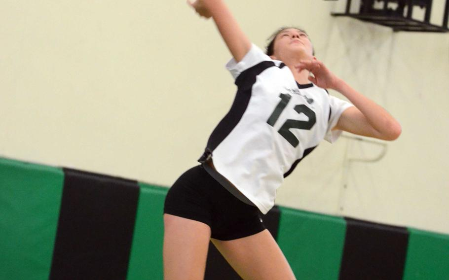 Daegu middle blocker Lari Robertson readies a jump serve against Humphreys during Friday's Korean-American Interscholastic Activities Conference girls volleyball match at Camp George, South Korea. The Warriors won 25-17, 25-7, 25-16, improving to 6-0 with all six wins coming in straight sets.