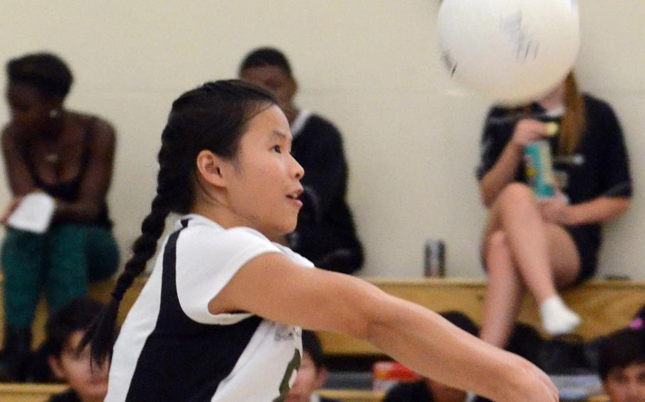 Daegu defender Rose O'Houlahan bumps the ball against Humphreys during Friday's Korean-American Interscholastic Activities Conference girls volleyball match at Camp George, South Korea. The Warriors won 25-17, 25-7, 25-16, improving to 6-0 with all six wins coming in straight sets.