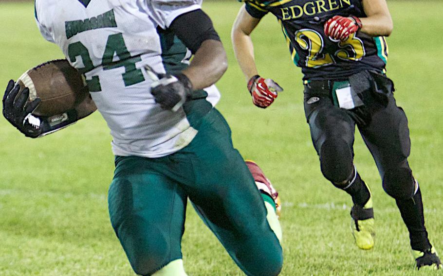 Kubasaki running back Jarrett Mitchell leaves Robert D. Edgren's Santiago Fleming in his wake during Saturday's high school football game at Misawa Air Base, Japan. The Dragons won 31-7. Mitchell rushed 14 times for 379 yards, third most by a player in Pacific high school history and most by an Okinawa-based running back.