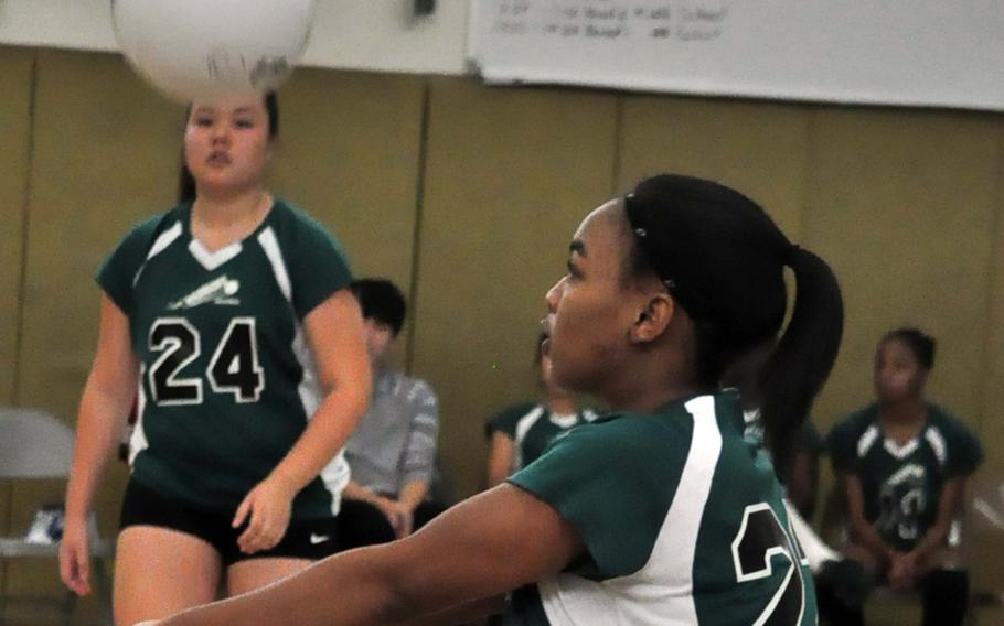 Daegu outside hitter Rheagan Wyche bumps the ball against Osan during Saturday's Korean-American Interscholastic Activities Conference girls volleyball match at Camp George, South Korea. The Warriors won for the seventh time this season, all in straight sets.