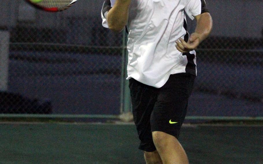 Kadena's Nicholas Lay hits a forehand return against Kubasaki doubles pair Brenden Neu and Mark Ebarle during Thursday's Okinawa Activities Council tennis tie at Kadena Air Base, Okinawa. Lay and Daniel Wartella teamed to beat Neu and Ebarle 6-2, 6-7 (3-7), 7-6 (7-5). Neu beat Lay in singles play 1-6, 6-4, 7-6 (7-0).