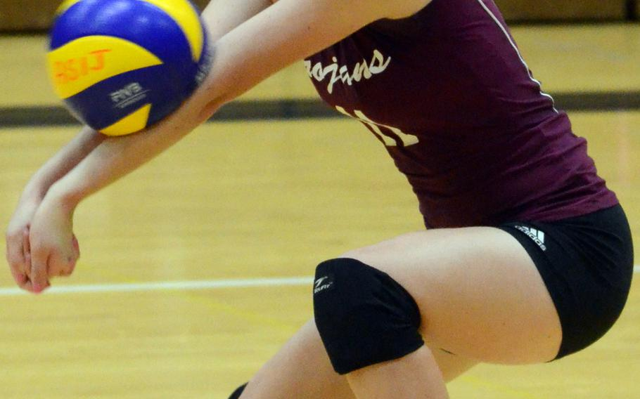 Zama American's Katrina Reid receives a serve against American School In Japan during Thursday's Kanto Plain Association of Secondary Schools girls volleyball match at ASIJ Chofu campus, Tokyo. The Mustangs remained unbeaten at 10-0, beating the Trojans 25-10, 25-7, 25-14.