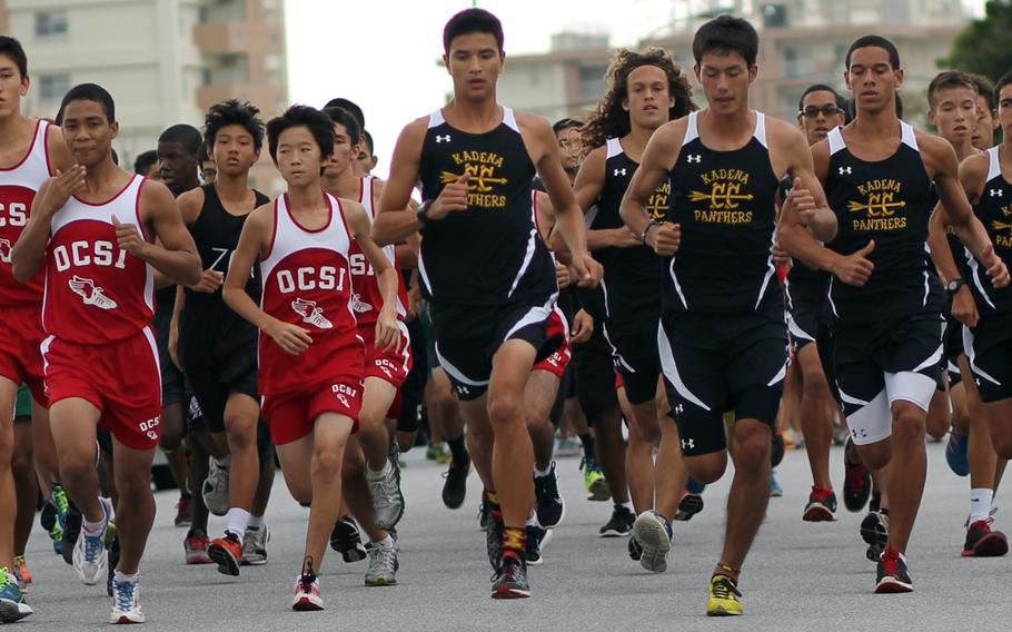 Kadena senior Andrew Kilkenny, middle, the reigning Far East champion, leads the pack at the start of Wednesday's Okinawa Activities Council cross-country meet at Camp Foster, Okinawa. Kilkenny won in 16 minutes, 8 seconds, best time for a DODDS Pacific runner this season and also a school and district record.
