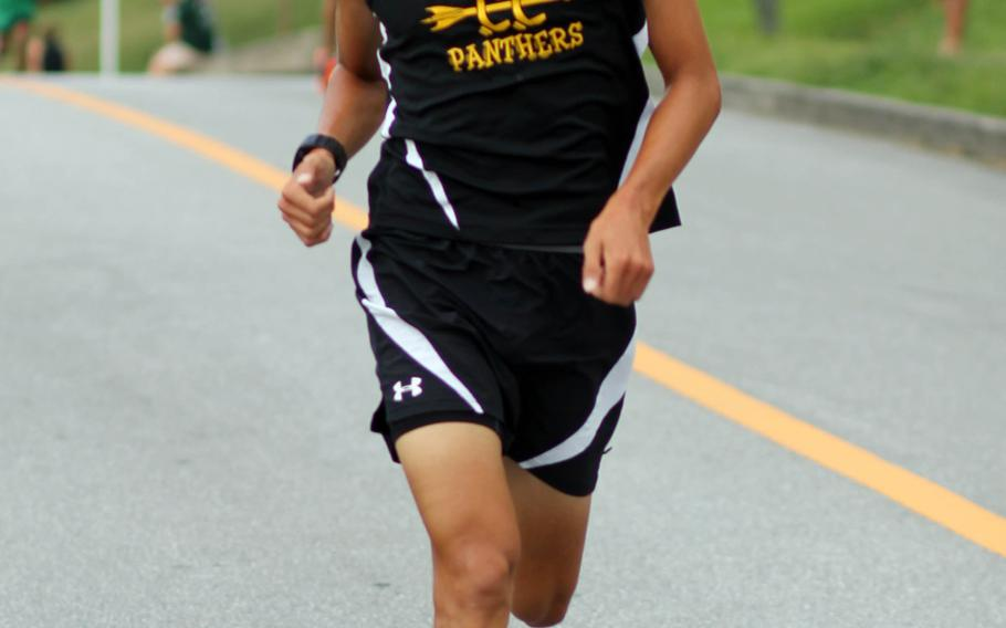 Kadena senior Andrew Kilkenny, the reigning Far East champion, heads for the finish of Wednesday's Okinawa Activities Council cross-country meet at Camp Foster, Okinawa. Kilkenny won in 16 minutes, 8 seconds, best time for a DODDS Pacific runner this season and also a school and district record.